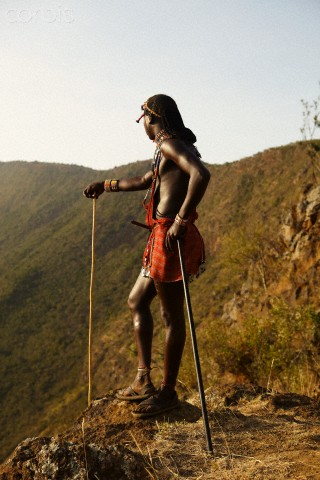 Maasai warrior standing on the edge of Suswa crater